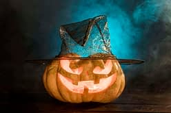 spooky carved pumpkin with hat
